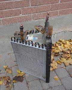 Plugged air conditioning coil removed from a residential gas furnace