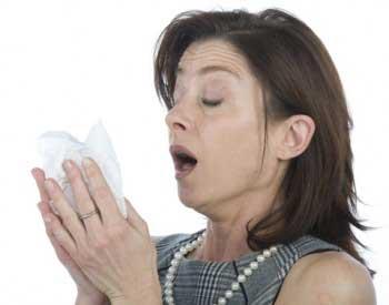 Homeowner sneezing